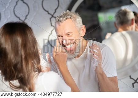 Man And Woman Doing Childish Things With Shaving Foam