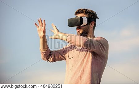 Virtual Reality. Game Online. Virtual Reality Goggles. Handsome Man With Wireless Vr Glasses Headset