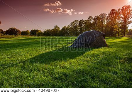 Haystack On A Meadow In The Evening In The Countryside. Summer Season. Ukraine. Europe.