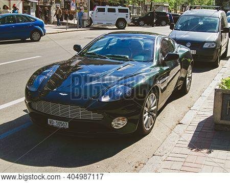 Kiev, Ukraine - May 14, 2011: English Supercar Aston Martin Vanquish In The City. Green Aston Martin