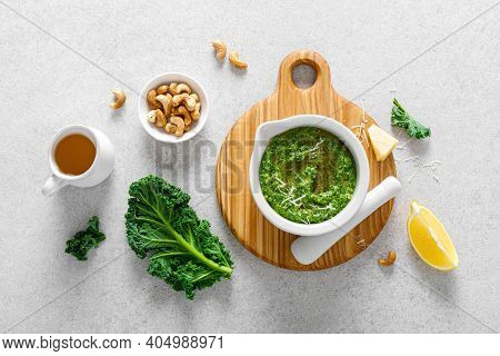 Pesto Kale With Ingredient For Cooking On Home Kitchen Table, Top View