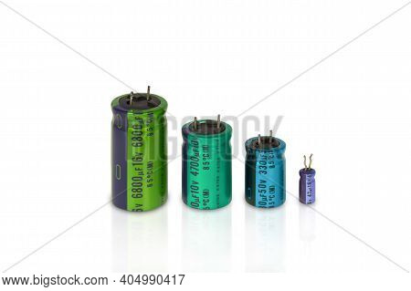 Electrolytic Capacitors Row With Multi Colors On A White Background