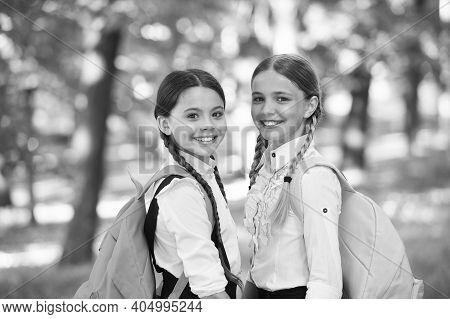 Clever Friends. Back To School. Small School Girls Walk In Spring. Happy Childrens Day. Childhood Ha