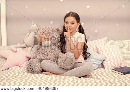 Girls Secret. Cute Kid Show Silence Finger Gesture. Little Secret. Small Girl Play With Teddy Bear I