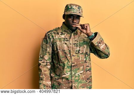 Young african american man wearing army uniform mouth and lips shut as zip with fingers. secret and silent, taboo talking