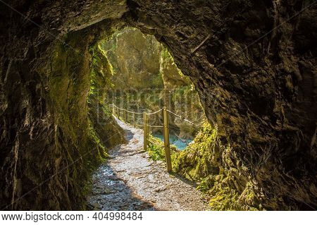 The Footpath Along The Tolminka River Which Flows Through Tolmin Gorge Cuts Through A Rock Tunnel In