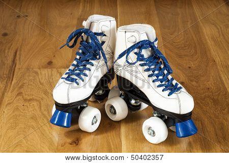 Two White Roller Skates