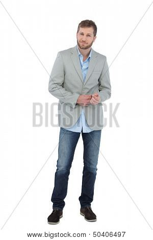 Suave man in a blazer posing on white background