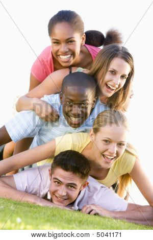 Group Of Teenagers Having Fun Outdoors