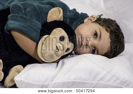 Child Laying In Bed