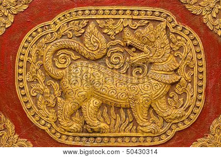 Singha Wall Sculpture On Ubosot In Wat Saen Fang , Chiangmai Thailand