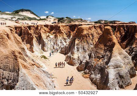 Tourists On The Rocky Beach