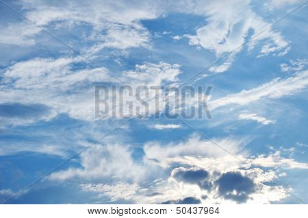 Sky With Fluffy And Spindrift Clouds