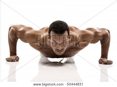 Muscle man dmaking push ups in studio, isolated over a white background poster