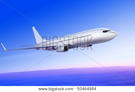 flying-up white passenger plane in the sky at sunrise