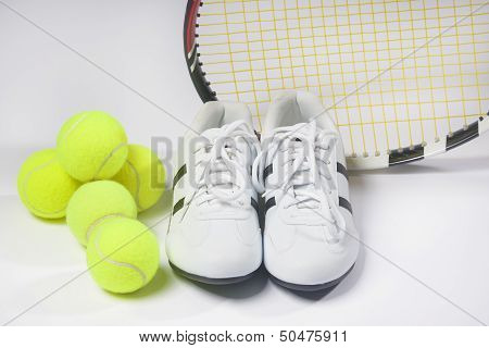 Tennis Raquet,tennis  Balls And Sneakers Against White. Horizontal Image