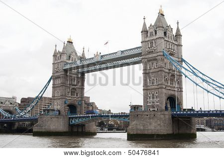 Tower Bridge (built 1886-1894) is a combined bascule and suspension bridge in London which crosses the River Thames. It is close to the Tower of London from which it takes its name and has become an iconic symbol of London. poster