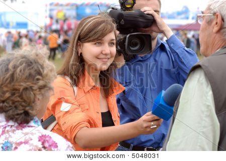 Smiling Female Tv Reporter