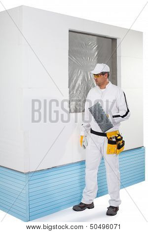 Worker Holding A Finishing Insulation Rasp