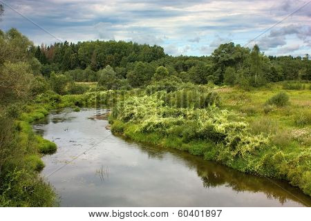 River In Countryside In Cloudy Day