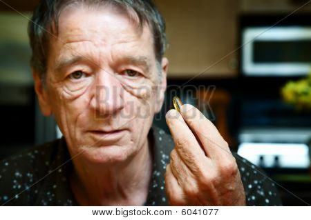 Senior Man With Daily Supplement