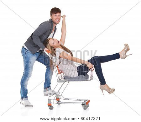 Man Shopping With His Wife In A Trolley