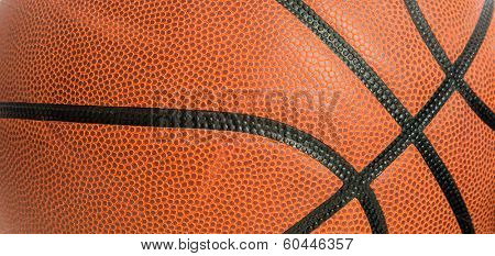 An orange leather basketball as a background