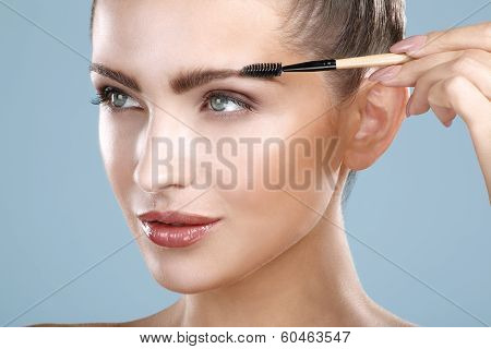 Closeup Beautiful Woman With Eyebrow Brush Tool