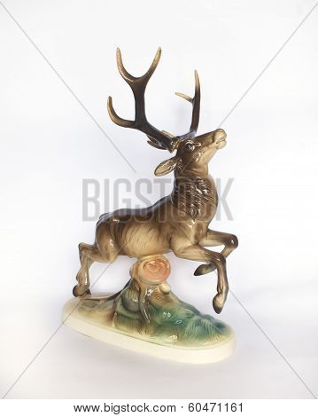 Antique Porcelain Figurine Of A Deer On A Log