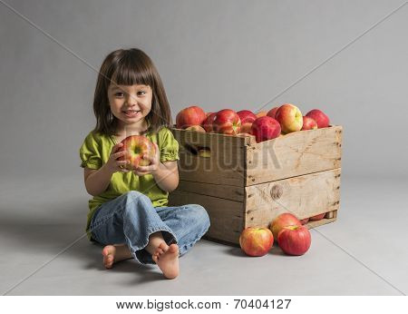Child With Crate Of Apples