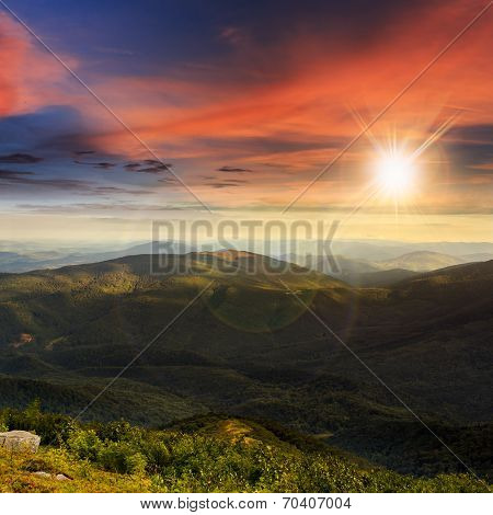 Stone Mountain Slope With Forest At Sunset