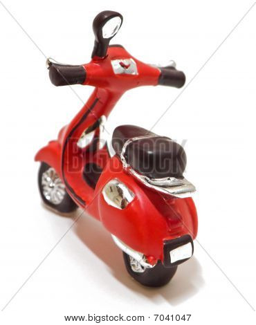 Red scooter toy isolated on white.