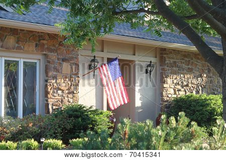 A nice house with a large American flag