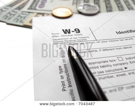 Time to fill out the annual revenue w-9 (w9) tax form for 2010 year by ink black pen. april tax deduction concept. poster