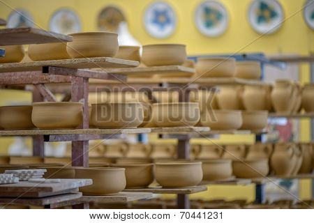 Shelves With Clay Dishware