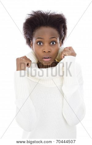 Scared And Shocked African American Black Woman In White Sweater.