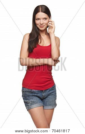 Toughtful casual woman talking at cell phone
