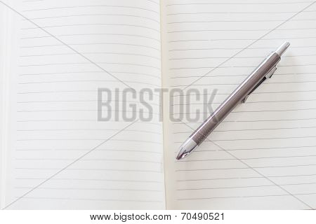 Open A Blank White Notebook And Pen