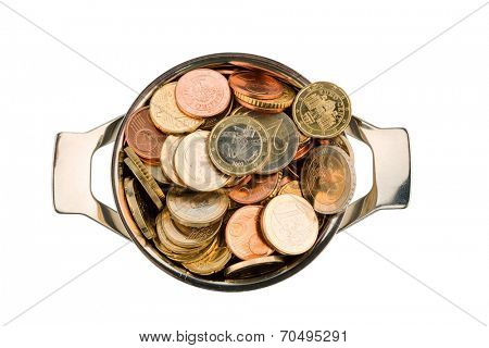 a pressure cooker is filled with euro coins, symbolic photo for grants and subsidies