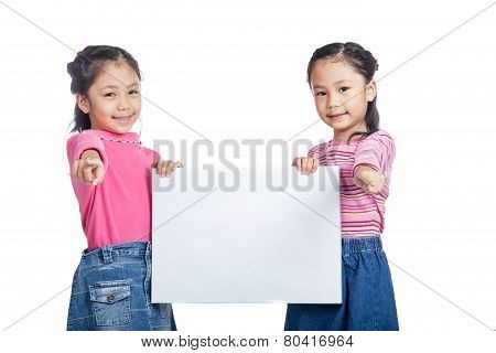 Asian Twin Sisters  Hold A Blank Sign  Point To Camera