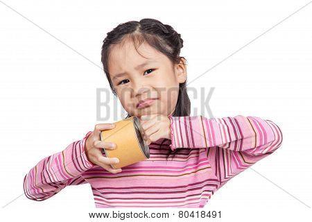 Asian little girl cannot open a can