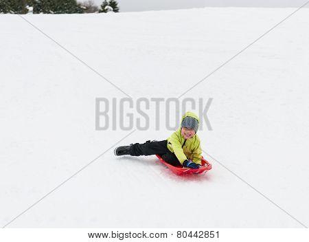 Boy On Sledge