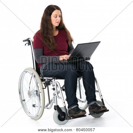 young woman in wheelchair working with the computer poster