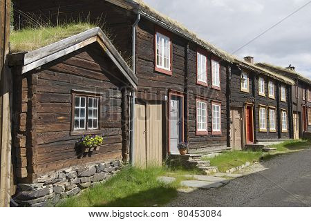 Traditional houses and church bell tower exterior of the copper mines town of Roros Norway.