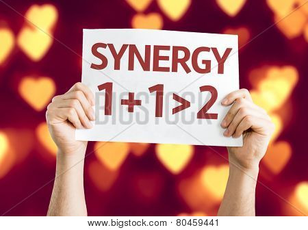 Synergy 1+1>2 card with heart bokeh background