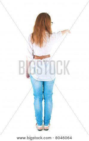 Young Woman Points At Wall.