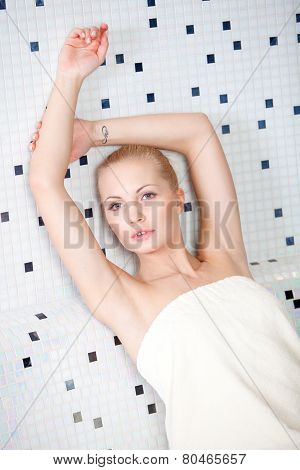 Pretty blond woman resting in a spa and wellness resort