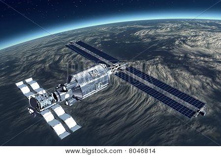 Telecommunication Satellite flying over Earth