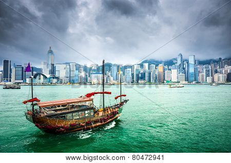Hong Kong, China Junk Boat sailing in Victoria Harbor.