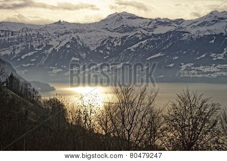 Sunrise Over The Thun Lake In Swiss Alps In Winter
